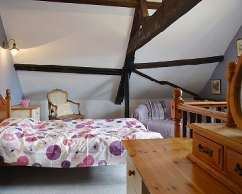 A well furnished attic bedroom.
