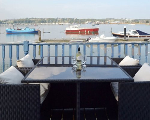 An outdoor dining area alongside the harbor.