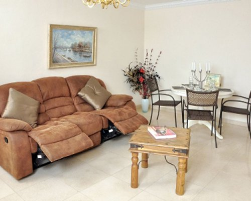 A well furnished living and dining area with pull out sofa.
