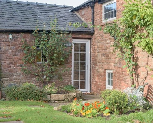 Scenic exterior view of Wetheral Cottages.