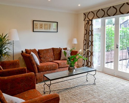 A well furnished living room with a sofa and outside view.
