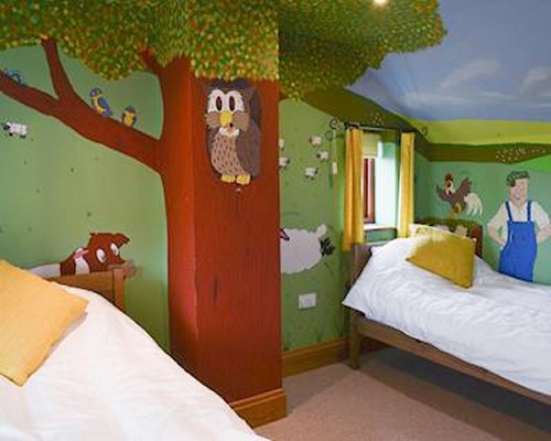 A youth bedroom with twin beds and painted walls.