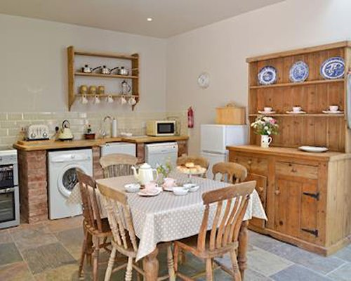 A well equipped open kitchen and dining area.