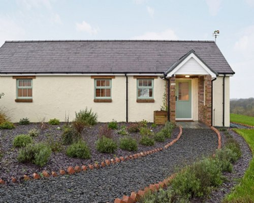 Exterior view of Blaenffynnon Barn with gravel pathway.
