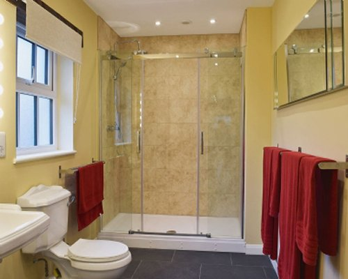 A bathroom with shower stall and sink.
