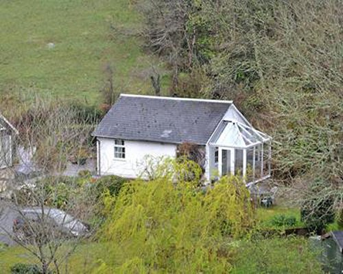 An aerial view of white cottage exterior.