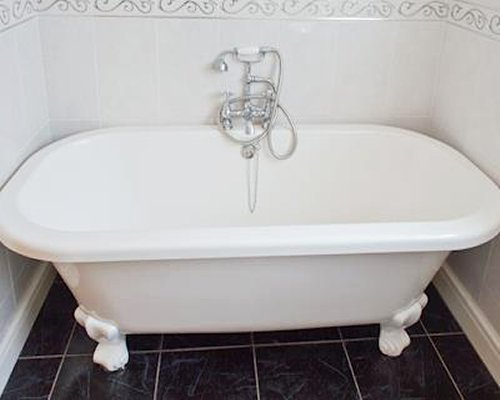 A bathroom clawfoot bathtub.