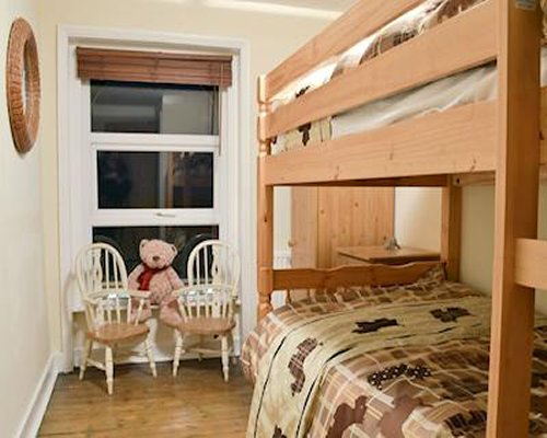 Bedroom with a bunk bed, chairs and window.