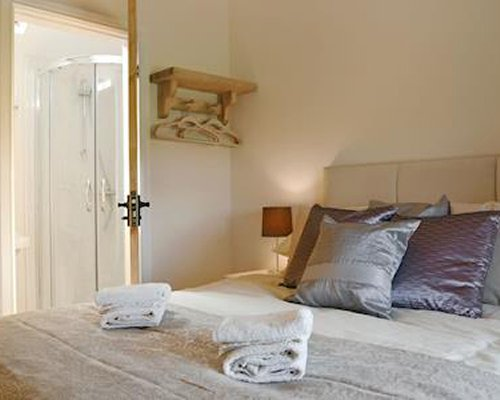 A spacious bedroom with a double bed.