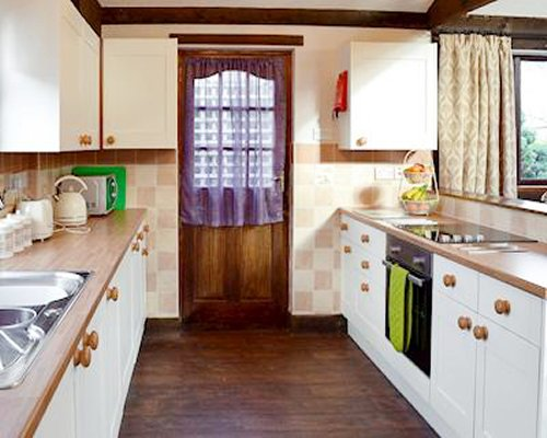 A kitchen with a microwave oven and stove.
