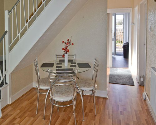 A well furnished dining area with staircase.