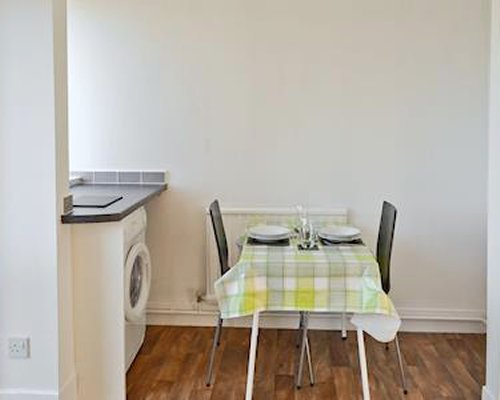 A well furnished dining room with washing machine.