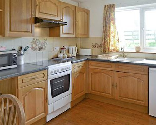 An open plan kitchen and dining area..