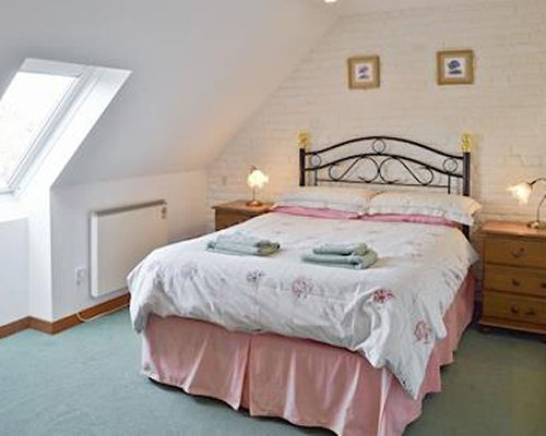 A well furnished bedroom with a bed.