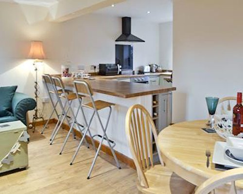 An open plan kitchen and dining area with a breakfast bar.