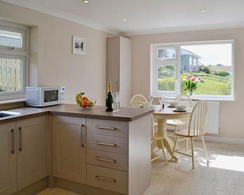 An open plan kitchen and dining area with an outside view.