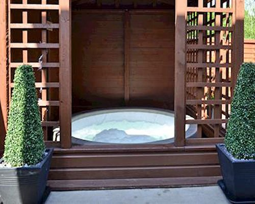 A hot tub in an outdoor gazebo.