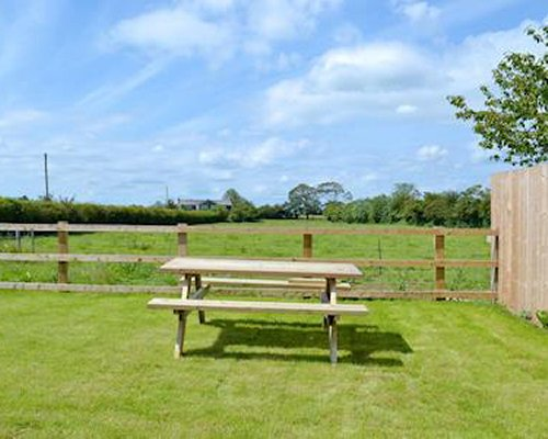 Scenic outdoor play area with picnic table.