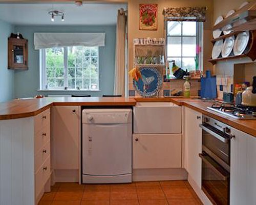 A well equipped kitchen with a dishwasher.
