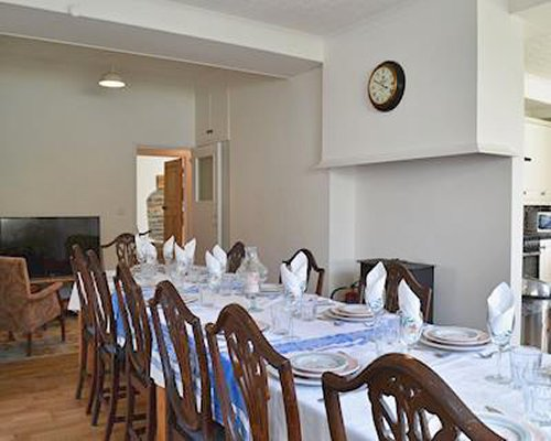 A well furnished dining area with television.