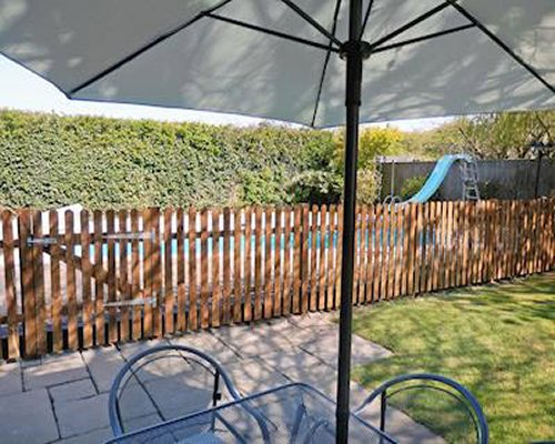 An outdoor picnic area with patio furniture and landscaping.