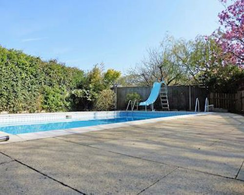 Outdoor swimming pool with a slide.
