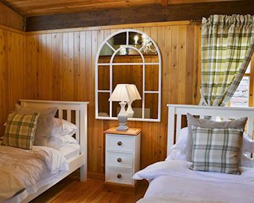 A furnished bedroom with two single beds.