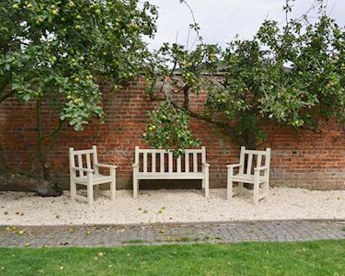 Patio with three chairs.