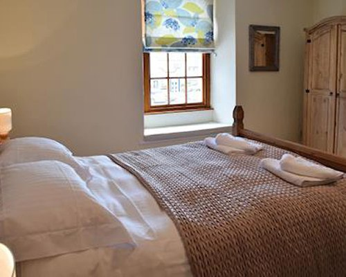 A well furnished bedroom with king bed and view..