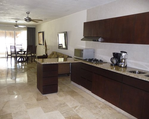 An open plan living room with kitchen and dining areas.