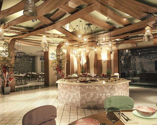 An indoor restaurant with a buffet.