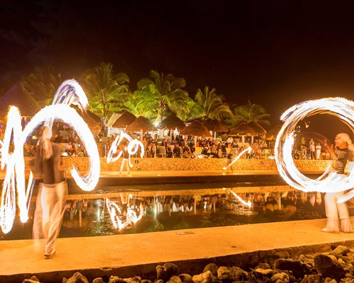 A group of people engaged in fire spinning.
