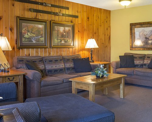 A well furnished living room with dining area breakfast bar and open plan kitchen.