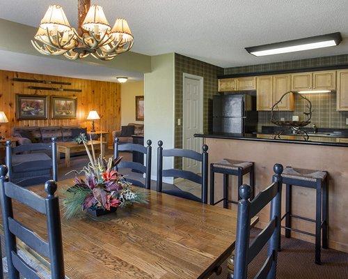 An open plan kitchen with breakfast bar.