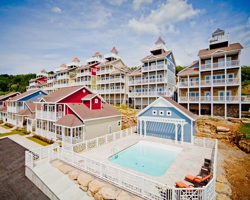 An aerial view of resort units with pool.