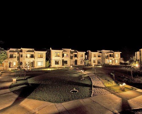 An outdoor pool alongside resort units.