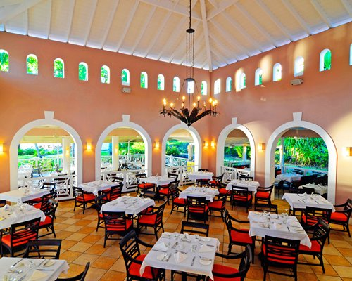 An indoor restaurant with outside view at St. James Morgan Bay.