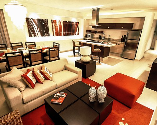 Living room with an open plan kitchen and dining area.