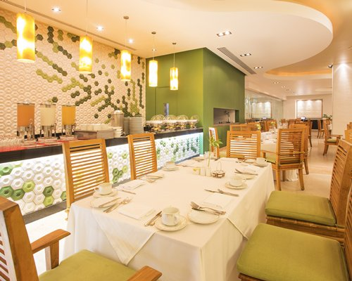 An indoor restaurant with a buffet at Marival Residences Luxury Resort.