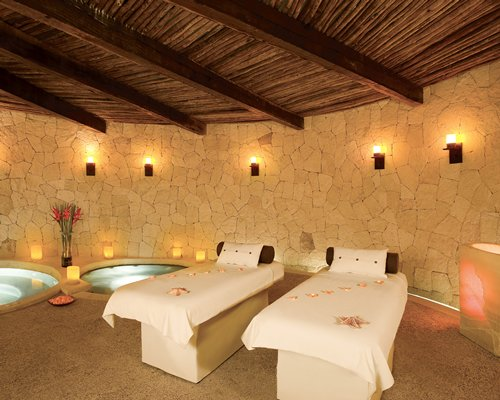 An indoor spa room with two hot tubs.