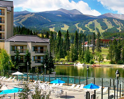 Exterior with pool lake and mountain view.