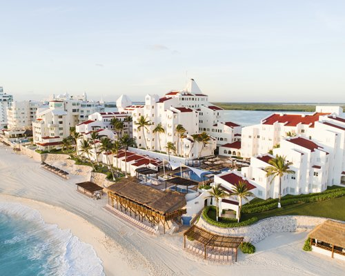 Exterior of resort on beach.