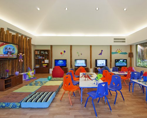 Indoor kids recreation room with television.