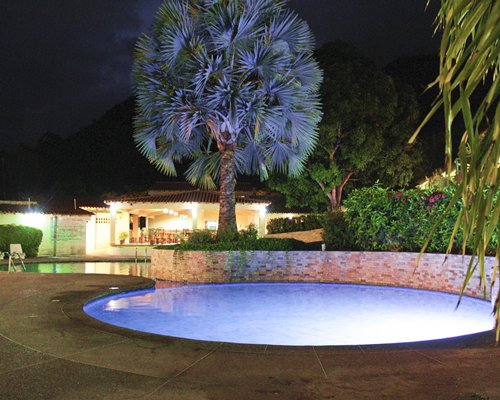 Outdoor swimming pool and hot tub.