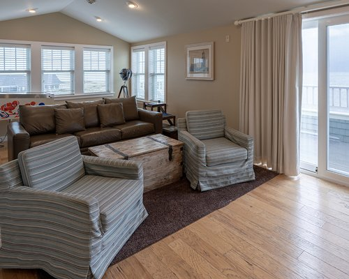A well furnished bedroom with a pull out sofa and television.