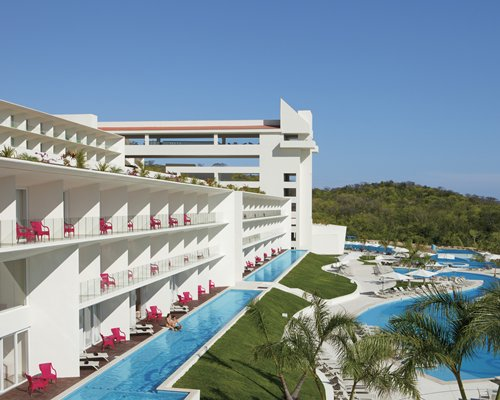 Exterior view of the resort alongside a swimming pool.