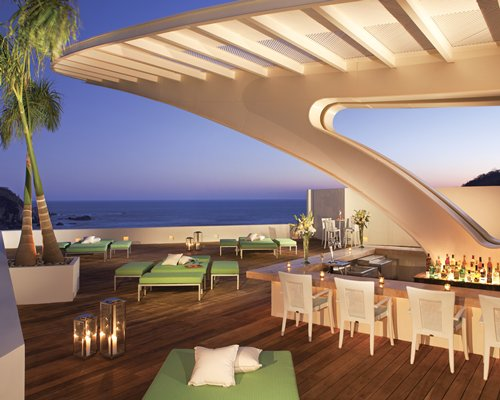 An outdoor bar with the ocean view.