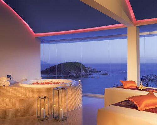 A well furnished indoor spa room with a hot tub.