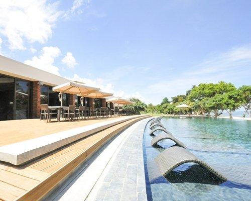 An outdoor swimming pool alongside resort units.
