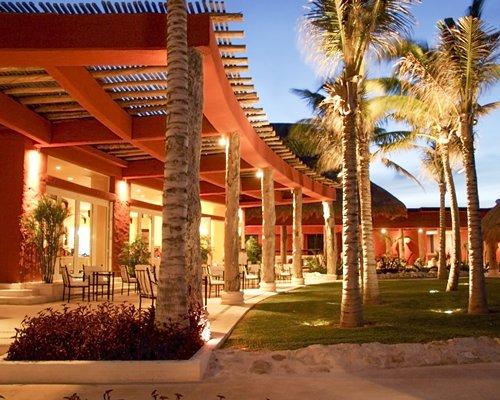 Scenic exterior view of Zoetry Paraiso De La Bonita with outdoor dining area.